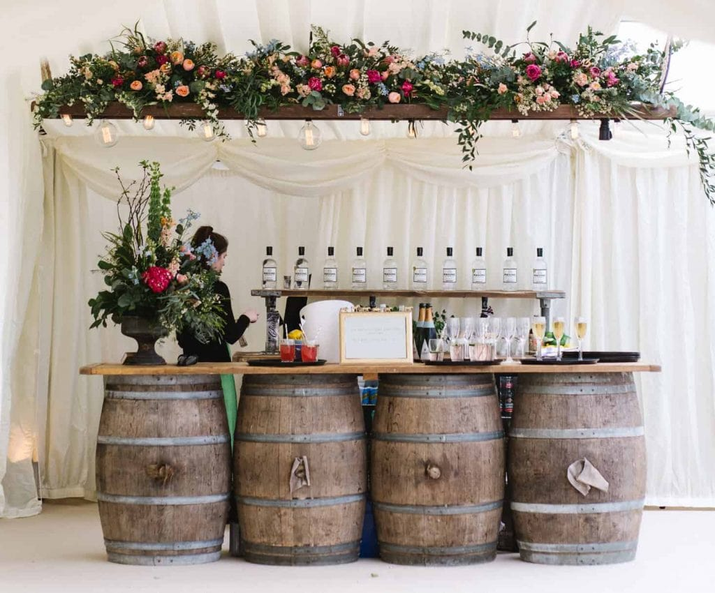 floral bar arrangement with barrels